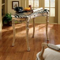 Zebra Writing Desk by Butler Specialty Co. $969.00. The Zebra Writing Desk brings an exotic touch to your home or office with a fossil stone veneer top and zebra skin design. Legs are beautifully hand carved with a tribal figure at the joints. A center drawer holds paper and writing implements.Place your order today and bring the wilds of Africa to your office.