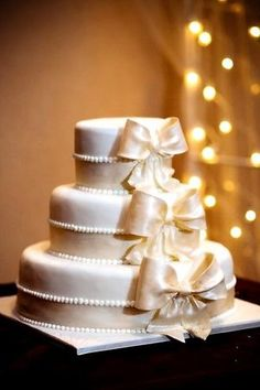 This will one day me vanessa marie's cake :) Reasons why: Its GOLD and it has BOWS!!!