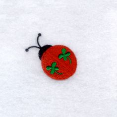 "Lucky Ladybug Stitches: 3393 1.69"" H X 1.76"" W 43 mm x 45 mm On Sale for:   $FREE  Sale Ends:   (6/28/2014)  From Starbird Designs"