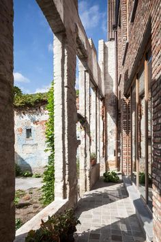 Gewad apartment block by Atelier Vens Vanbelle features brick walls and a mirrored atrium