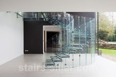 Feature all glass staircase for residential project in Surrey, UK www.stairs-siller.com