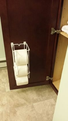 This is what I did in my bathroom. Toilet paper organizer hung with Command Strips for easier reach! Paper Organization, Bathroom Organization, Organizing, Command Hooks, Command Strips, Camper Hacks, Bathroom Toilets, Storage Hacks, Toilet Paper