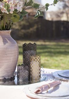 Add a touch of elegance to your wedding with these beautiful DIY wedding candle holders made from mosaic aluminum sheets.