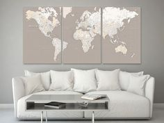 Large multi panel world map canvas print, highly detailed world map with cities. Color combination: light earth tones