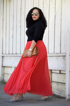 Girl With Curves blogger Tanesha Awasthi wears a maxi skirt, turtle neck and lace-up animal print flats.
