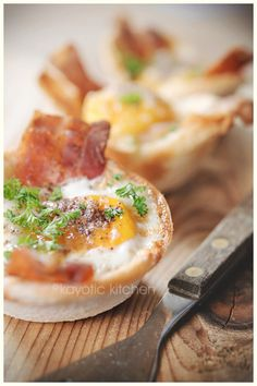 Eggs, Bacon & Toast Cups...these would be great for a brunch; easy to feed lots of people at once. I would just switch out the white bread for wheat...