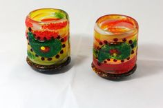 """Shabbat votive with paisley pattern. Versatile - the upper part is separate from the bottom so that any kind of candles can be used. Transparent and opal glasses. Measure approx. 3"""" X 3""""."""