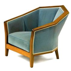 French Art Deco: Armchair by Pierre Chareau. Walnut and fabric upholstery. Circa 1924.