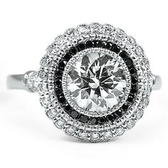 Black Diamond Bella Ring from Brilliant Earth.....love the black and halo but not sure about round though does look cool