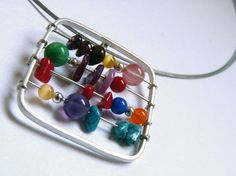 Abacus Necklace from aforfebre.  Perfect gift for a math teacher ;)