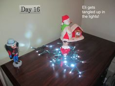Eli the elf gets tangled in the lights