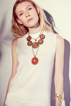 Layer statement necklaces.