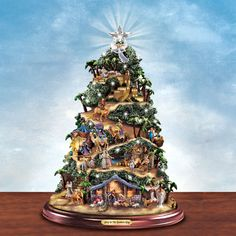 Thomas Kinkade Christmas Tree (click on picture to see detail) Plays Silent Night and is lighted
