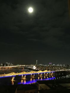Full moon, by night, over Han River, Seoul, South Korea
