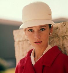 Audrey Hepburn with a cream-colored version of the rounded hat
