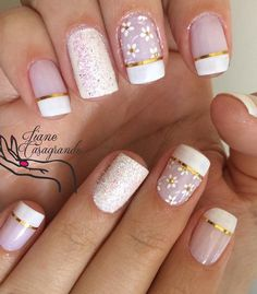 The classic French tip? Check. Metallic gold strips? Check. Floral design?…