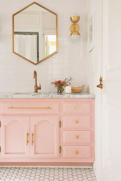 Pink bathroom with golden brass accents