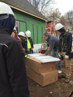 Ed demonstrating how to install InSoFast insulation panels to a group of teenagers volunteering for Urban Homeworks.