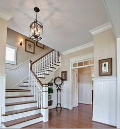 Gorgeous entry - love the colours the light the stairs - everything!
