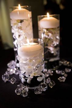 The white flowers, crystals and candles look awesome against the black tablecloth