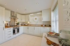 Grey silver kitchen taylor wimpey show home kitchen for Perfect kitchen bramley