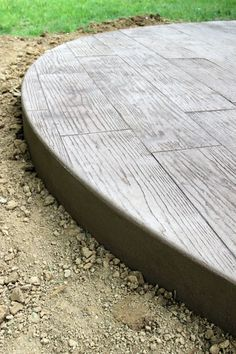 """""""wood"""" stamped concrete. very cool << it really is! Maybe colored as an alternative to tile?"""
