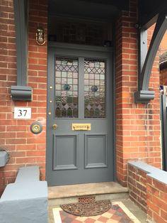 Farrow And Ball Grey Exterior Home Exterior Door Grey Exterior Door Colors, Grey Exterior, House Paint Exterior, Exterior Doors, Craftsman Exterior, Yellow Front Doors, Painted Front Doors, Orange Brick Houses, Red Brick Exteriors