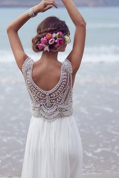 Madison wedding dress, Anna Campbell. Pearl and silver beaded bodice with a plunging back, silk chiffon skirt and delicate neckline.  #wedding #dress