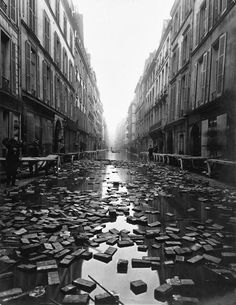This haunting photograph shows books floating in the street after a library was flooded from the Great 1910 Parisian Flood.