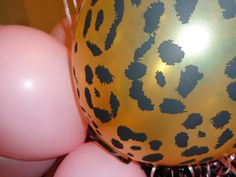 We had balloons all over, by the entrance, on the playroom floor, on the gift table, on the favor table.  We grouped the leopard balloon with soft pink balloons.  And as each child left we gave them a fistful of balloons to take home (the boys opted for the leopard while the girls favored the pink - go figure:)