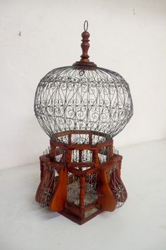 Vintage bird cage.  Have this exact cage, only I think mine is a little bigger....anyone have any idea as to age?
