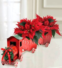 Hmmmm...poor man's version: a milk carton, aluminum can, movie theatre candy box, 2 Chinese take out boxes, peppermints, dollar tree flowers...think even I could make this