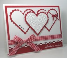 handmade Valentine's card ... red and white ... trio of white die cut hearts matted on scalloped edge red hearts ... each with a different decoration ... red gingham ribbon ... pretty card!
