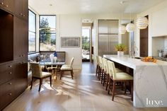 Modern White Kitchen with Glass Breakfast Table https://luxesource.com/collection/3223/59342
