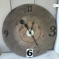 Made this clock from a discarded wooden wire spool. Numbers are from the habitat for humanity restore, clock mechanism purchased with coupon from hobby lobby. Had to use a jig saw to make circle in the center bigger because center of the clock mechanism wasn't long enough. Covered center with a .10 metal piece from the restore.