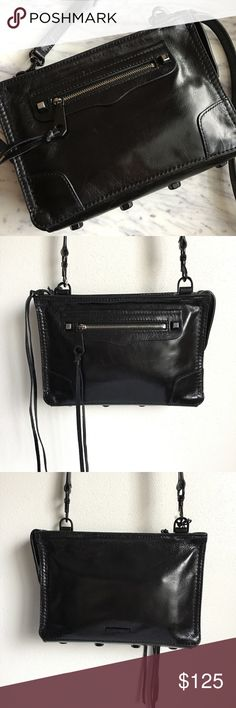 "NWT Rebecca Minkoff Regan Crossbody Bag Black NWT Rebecca Minkoff Regan Crossbody Bag Black.  A chic clutch shaped from supple cowhide leather features long, trailing laces for a bit of flirty movement with every step.  Top zip closure. Optional crossbody strap. Exterior zip pocket. Interior wall pocket. Protective metal feet. Print jacquard lining. Leather. 9""W x 6""H x 2 ½""D. 22"" - 25 ½"" crossbody strap drop. Rebecca Minkoff Bags Crossbody Bags"