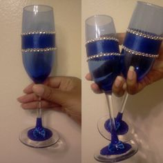 DIY royal blue champagne glasses. Glasses from dollar tree.  Bling also from dollar tree. The the bottoms of the classes are decorated with royal blue glitter dust and hand made 1 minute bows.  Bride on a budget!