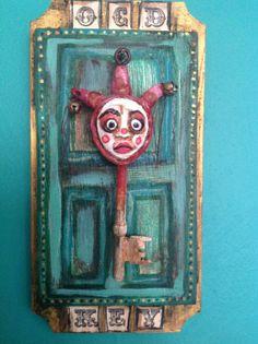 Handmade Mixed Media Jester OCD key wall by Uncanny Curiosities.