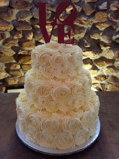Beautiful Red Velvet Wedding Cake Filled With Cream Cheese Frosting And Covered In Swirls Of Er