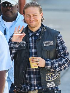 Star Tracks: Tuesday, June 3, 2014 | CHARACTER STUDY | Look at that smile! Charlie Hunnam waves to adoring fans during a break from filming the upcoming season of Sons of Anarchy in Los Angeles on Monday.