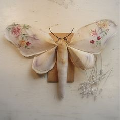 ❤ it . . . Moth made from vintage fabric. Soft sculpture. Beautiful little moth made from rescued fabrics. Each made vintage tablecloths,samplers bedlinen,knapkins and anything else that has beautiful embroidery on. Flaws, age marks, sometimes tiny printed numbers & odd stitching are celebrated & are to be expected. ~By MisterFinch