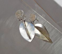 Flower Bud Earrings in Sterling Dangle from Silver Posts, Nature Inspired Organic Shape , Made by a Metalsmith by TahoeJewelryandArt on Etsy https://www.etsy.com/listing/153238476/flower-bud-earrings-in-sterling-dangle