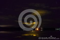 Photo about A cloudy night. Stars in dark blue sky. Reflection of the clouds on water. Image of reflection, moving, littoistenjacurren - 108149180