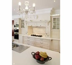 It's all about Detailed Joinery, French Provincial by Wonderful Kitchens    Stunning french provincial kitchen with chandelier !