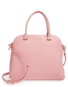 Add some Kate Spade sophistication to the wardrobe with this oh-so-lovely pink leather satchel.