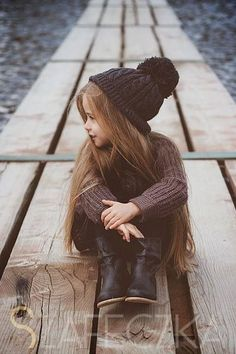 Oh she is just adorable, isn't she? A lil hipster. What a cutie! Love the #browntuque!