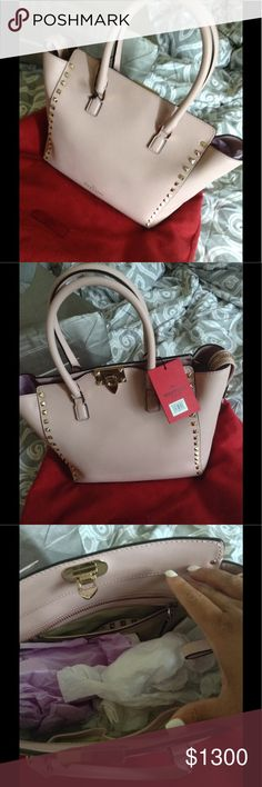 """Valentino Rockstud Small Double Handle LeatherTote This bag is new with tag and has never been worn  Current bag price is ($2295 online and $2495 in store) Size Info 9 ½""""W x 8 ½""""H x 6""""D 4"""" strap drop; 17 ½"""" shoulder strap drop.  Details & Care Sized just right for carrying essentials Floating top-zip closure with flip-lock closure Top carry handles Optional shoulder strap Interior zip, wall and smartphone pockets Protective metal feet Lined Leather Made in Italy Designer Handbags  Comes with…"""