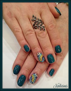 Petrol green nails with lahour design
