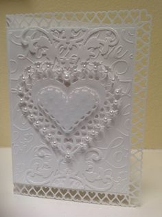 Wedding card made with Anna Griffin dies and embossing folder and Martha Stewart punch around the page punch