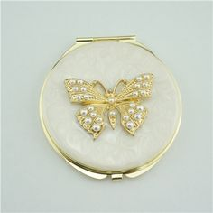 Butterfly pearl compact mirror/Compact mirror party favors  It is covered with ivory enamel glaze and mounted with bling-bling crystals.